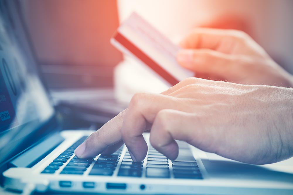 Man hands using credit card for purchasing online products and b